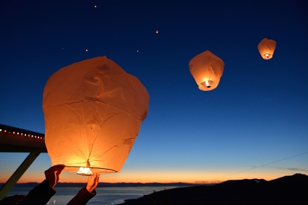 Make a wish, Paper Floating Lanterns release on Grouse Mountain, Vancouver Stock Photo