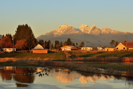 Fraser Valley Farm Houses and Golden Ears Mountain at sunset