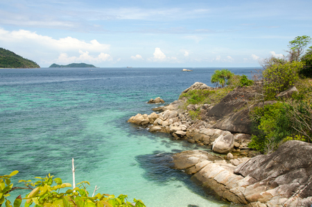Scenery of destination sea beach on small island, Group of traveler enjoying and relaxing on beautiful beach, Lipe island, Satun, Travel in Thailand, Summer holiday and vacation trip