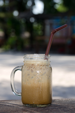 Cold coffee on wooden background Stock Photo