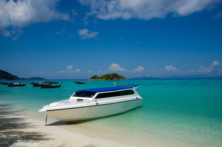 Speed Boat at tropical beautiful White Sand Beach Lipe sand, Satun, Thailand