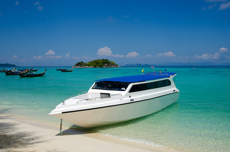 Speed Boat at tropical beautiful White Sand Beach Lipe sand, Satun, Thailand