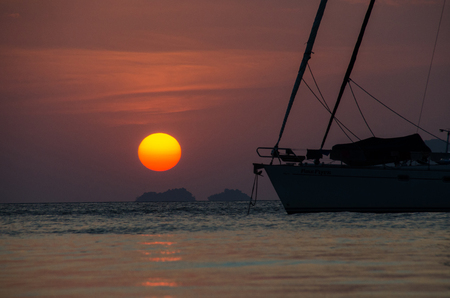 Silhouette sailing boat on the sea at sunset in Adang-Ravi Islandsin,Tarutao National Park, Satun Thailand. Stock Photo
