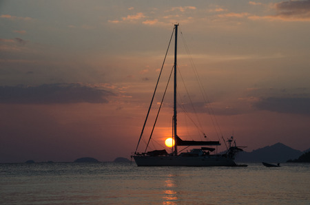 Silhouette sailing boat on the sea at sunset in Adang-Ravi Islandsin,Tarutao National Park, Satun Thailand. Stock Photo - 97229714