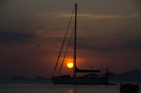 Silhouette sailing boat on the sea at sunset in Adang-Ravi Islandsin,Tarutao National Park, Satun Thailand. Stock Photo - 97229715