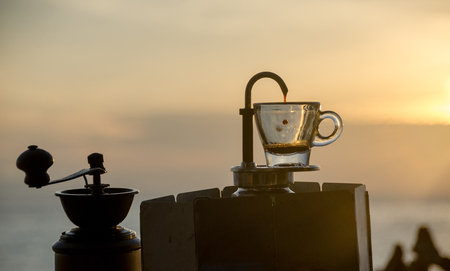 Fresh Coffee in the morning by mini Express Espresso Maker, Focus foffree drop. Stock Photo