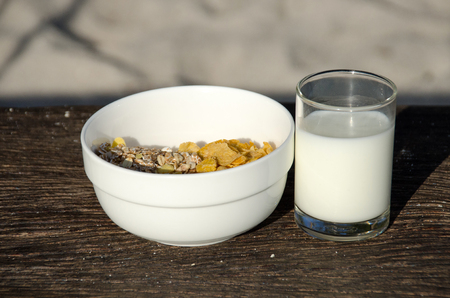 Conflex crispy and fresh milk on old wooden, healthy breakfast.
