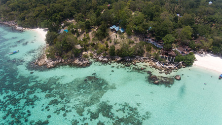 High aerial view of tropical beach and rocky coast with crystal clear turquoise water on Thai island, pattaya beach,Koh Lipe