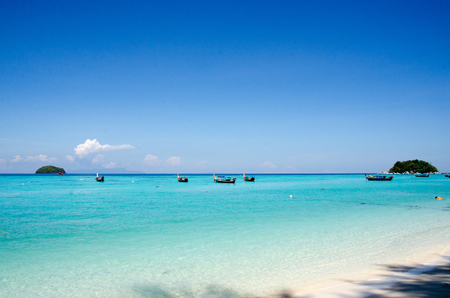 Sand and Andaman sea background, tropical beach travel concept smooth sea  and clear blue sea. travel concept. Koh Lipe, Satun, Thailand Stock Photo
