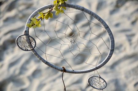 Dream Catcher with nature light on beach