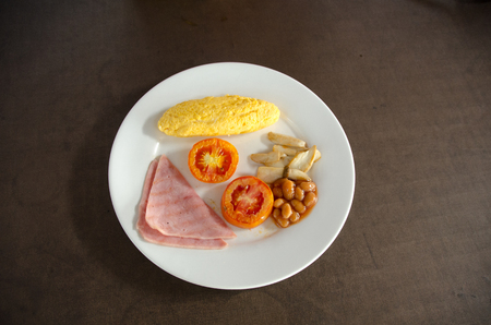 American Breakfast with omelet egg and ham