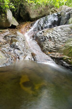 Nice small waterfall cascade on mountain river