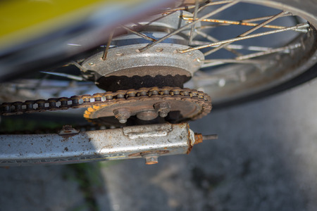 Old rusty motorcycle, chain, brake, shock absorber Stock Photo