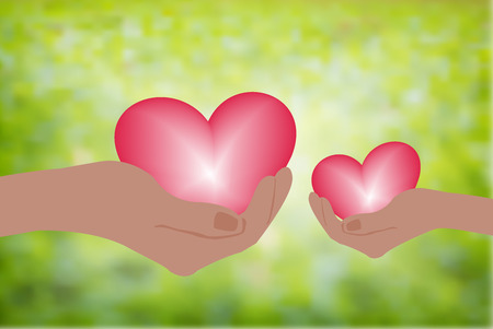 Hand holding heart.Give a pink heart with love.blurred green background