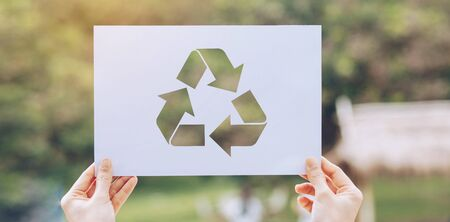 Save world ecology concept environmental conservation with hands holding cut out paper recycle showing