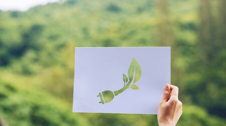 Save world ecology concept environmental conservation with hands holding cut out paper showing