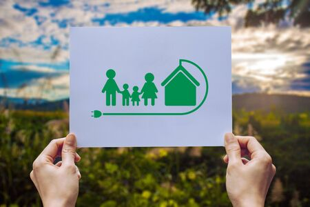 save world ecology concept environmental conservation with hands holding cut out paper earth loving ecology family showing Stock fotó