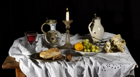 Classical Baroque Still-life in Dutch breakfast style on a black background
