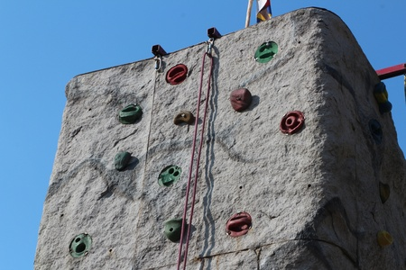 Artificial climbing rock in front of blue Stock Photo - 30521721