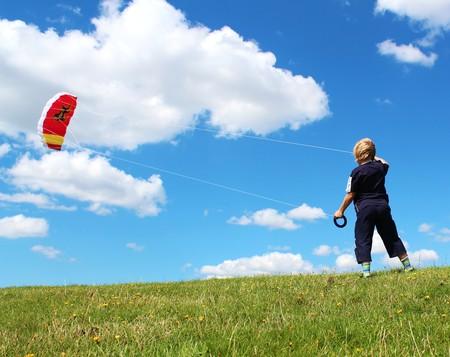 Boy is playing with stuntkite photo