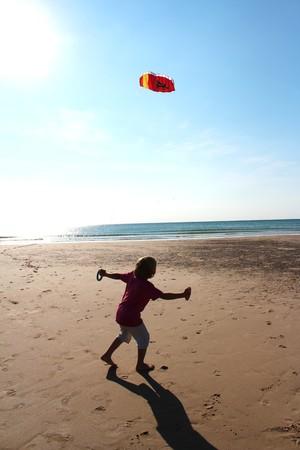 boy controls stunt kite photo