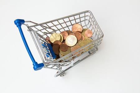 glut: Money in a shopping cart Stock Photo