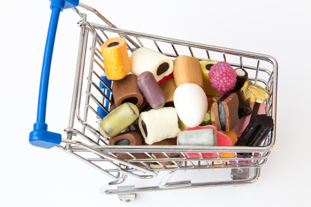 shopping cart full of sweets photo