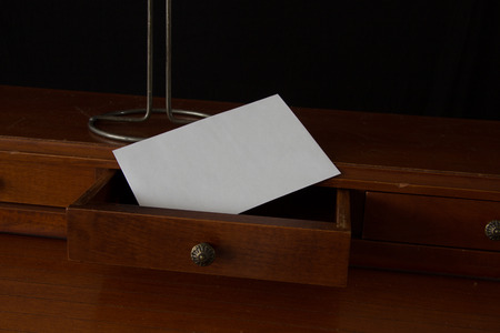 actuary: Old secretary desk with letter