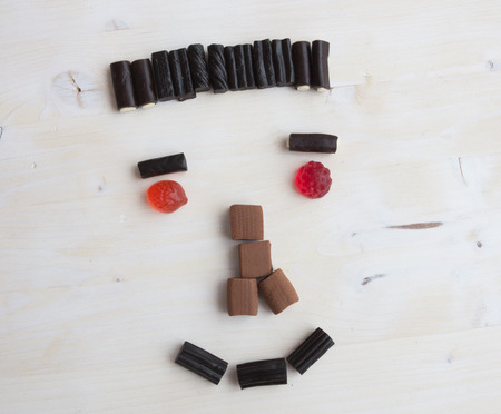 schematically: Laughin face out of sweets Stock Photo