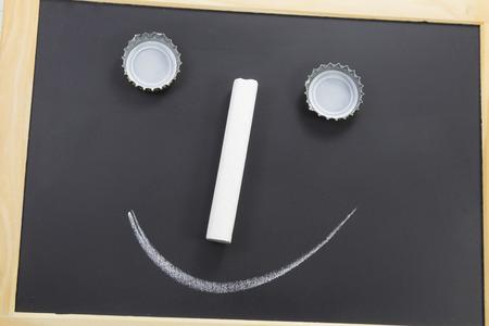 slate board: slate board with a face - near Stock Photo