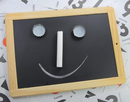 slate board: slate board with a face