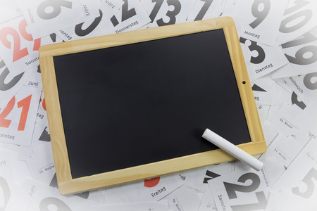 slate board: slate board on calendar sheets Stock Photo