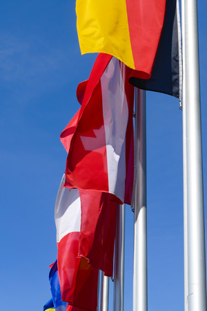 Many european flags are fluttering in the wind Stock Photo