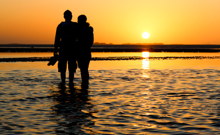 love couple: Love couple at sunset at the beach Stock Photo