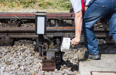 manually: Rail switch is manually adjusted