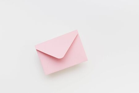 Pink envelope on the white background Stock fotó