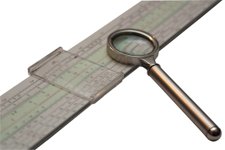 Slide rule and magnifier isolated on white background