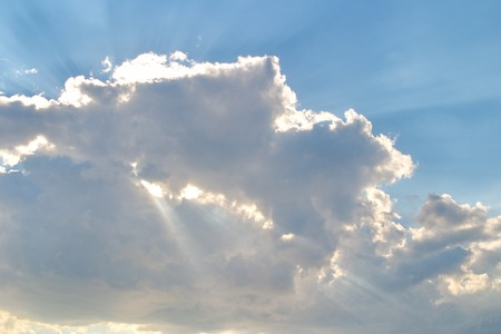 Blue sky with rays of sun through clouds. Low cloud. Stock Photo
