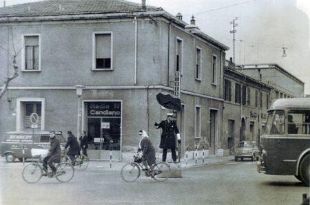 Ravenna, Italy - CIRCA late 1960s: Vintage black and white photo with Italian carabiner regulates traffic.