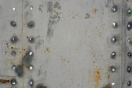 Metal texture with rust and rivets.