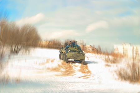 Blurred image of spectators riding on an armored personnel carrier.