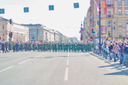 Blurred background image of a cordon of the soldiers during the procession of citizens.
