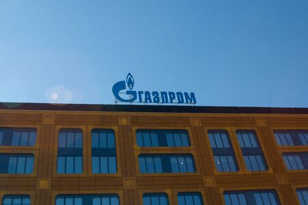 Saint Petersburg, Russia - April 06, 2019: Gazprom gas concern logo in Russian on the roof of the office building