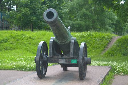 Image of an ancient bronze cannon on a pedestal in the Arsenal. Saint Petersburg