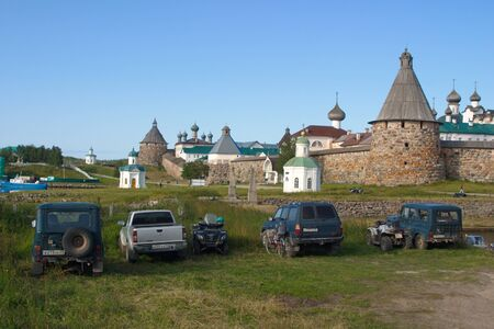 Solovetsky islands, Russia - August 10, 2019: SUVs and ATVs of local residents parked in front of the kremlin