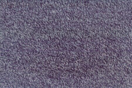 Blue wool knitted fabric texture as background