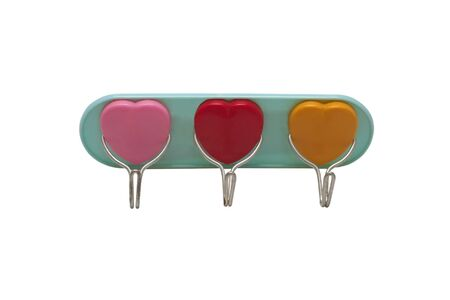 Image of plastic hooks for clothes in the form of hearts isolated on a white