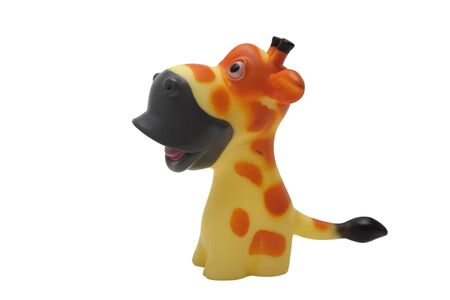 Toy rubber squeaking giraffe isolated on white