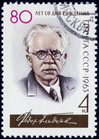 Saint Petersburg, Russia - February 01, 2020: Stamp issued in the Soviet Union dedicated to 80th Birth Anniversary of F.V. Gladkov. From the series on Birth Anniversaries, circa 1963 Editorial