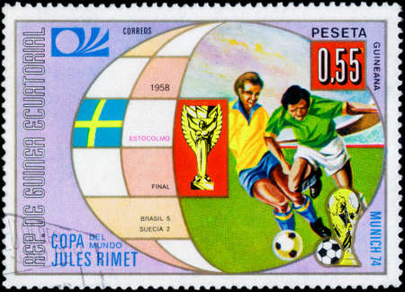 Saint Petersburg, Russia - March 06, 2020: Stamp issued in the Equatorial Guinea dedicated to Cities of Earlier Football World Cup finals, Stockholm, 1958. From the series on Football World Cup 1974, Germany, circa 1973